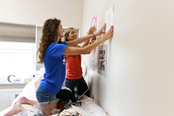 Students decorating dorm room