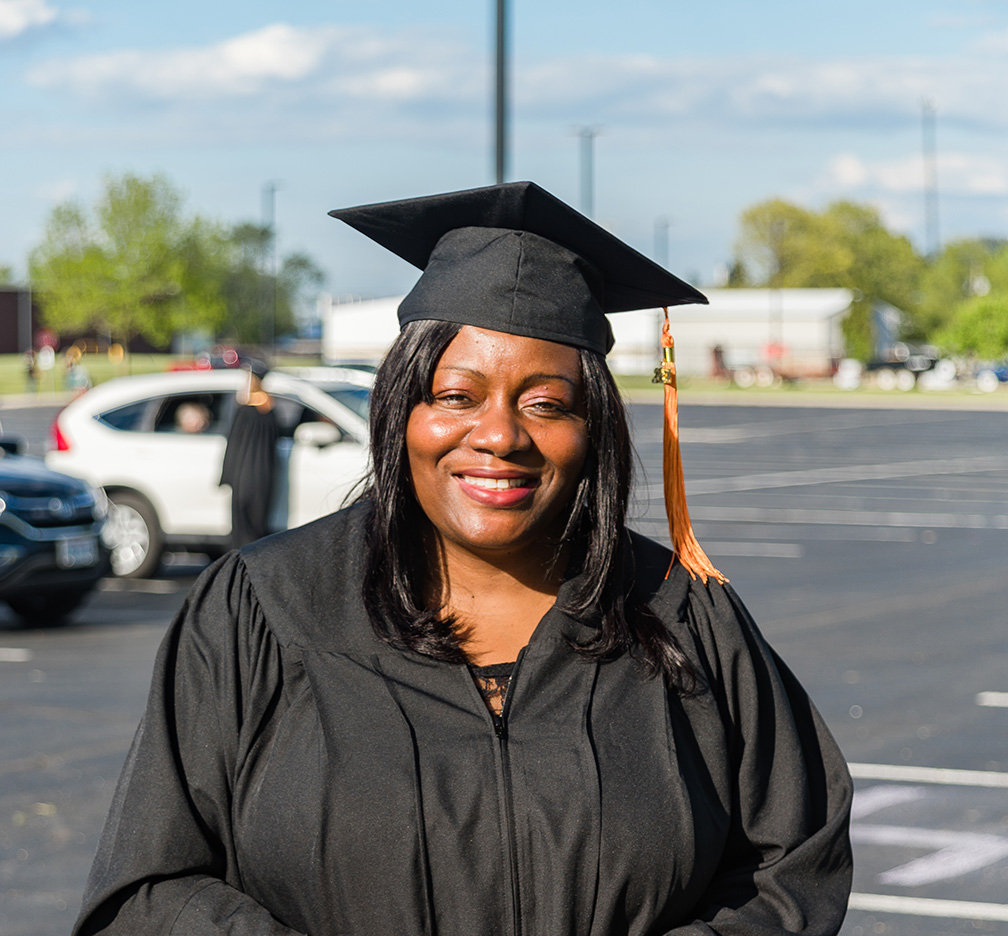 Student at graduation in cap and gown